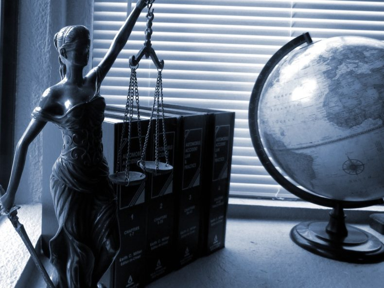 Lady Justice statue on a desk - photo from Pixabay and used under the Pixabay license